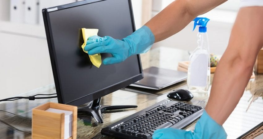 cleaning offices and desks to help prevent spread of coronavirus covid-19
