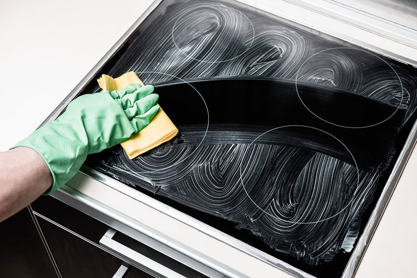 How do you clean a burnt glass stove top?