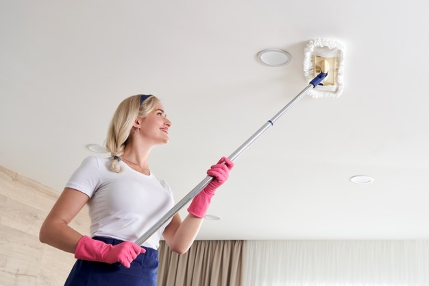 using a mop to clean popcorn ceiling